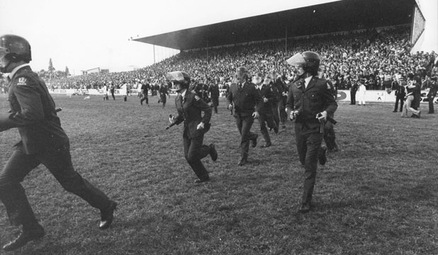 Police move in at Rugby Park, Hamilton, above, but the protesters had won. Below, Wynand Claassen looks at some of the nails thrown on to the pitch.