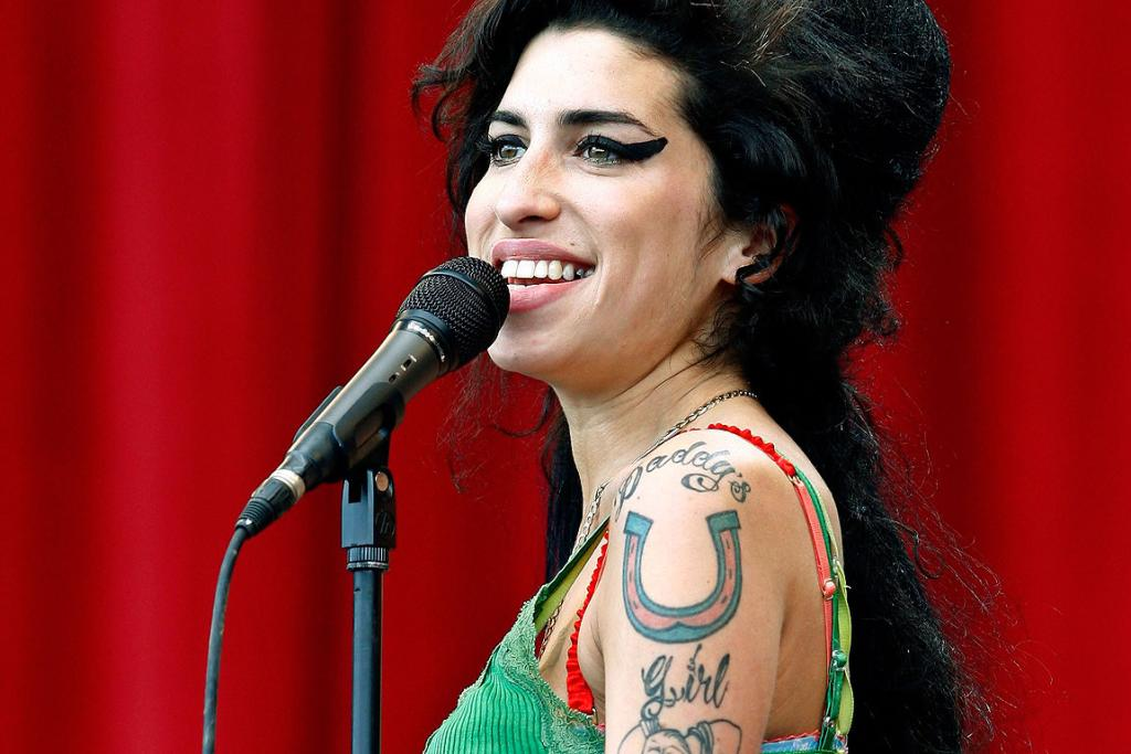 ON FIRE: Amy Winehouse performs at Glastonbury in 2007.