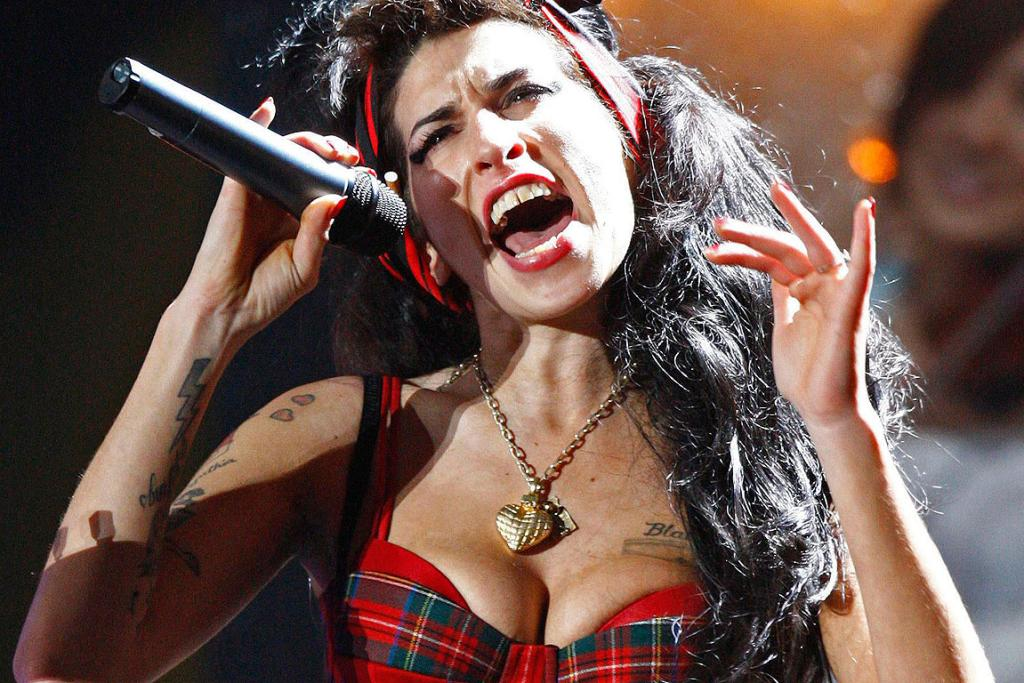 AWARDS SHOW: Amy Winehouse performs at the Brit Awards at Earls Court in London