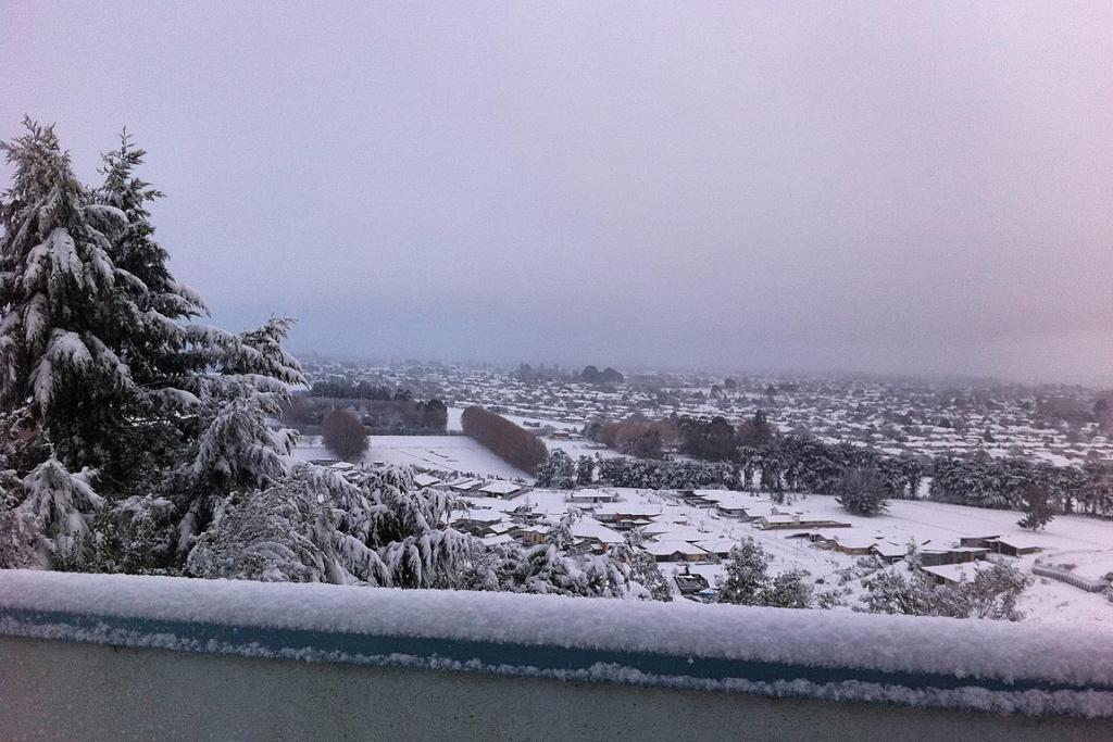 View of snow-covered suburbs from Westmorland, Christchurch.