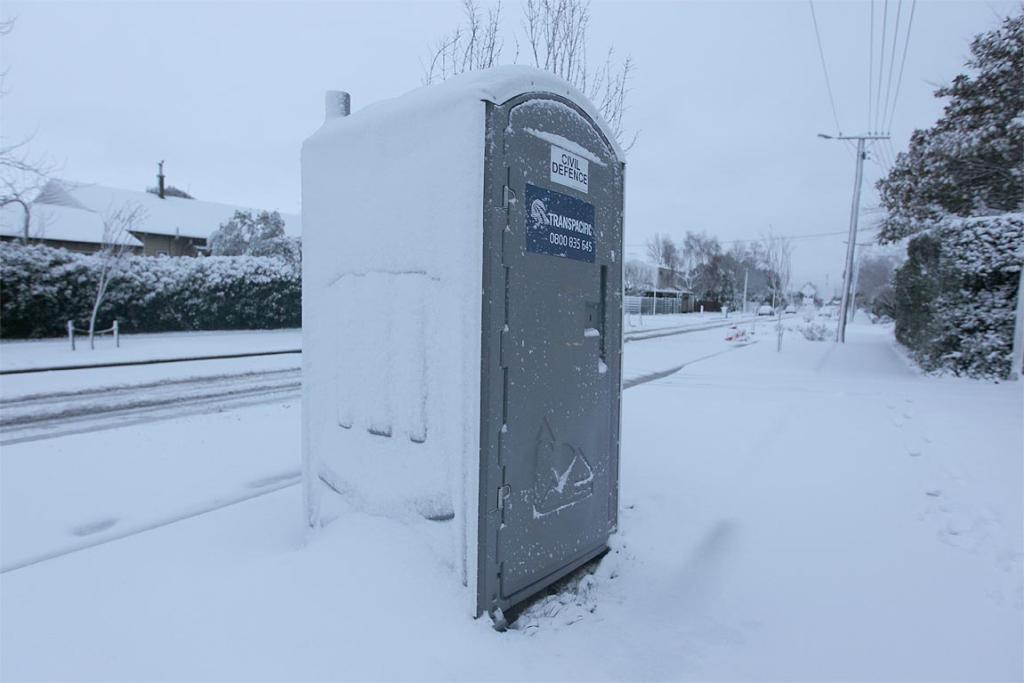 Snow covers everything on Weston Road, St Albans, Christchurch, including a civil defence portaloo put in place after the February Christchurch quake.