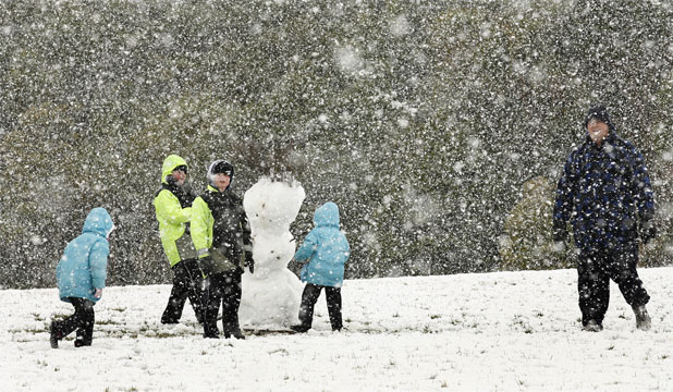 White Out Holidaymakers Enjoy The Snow And The Company Of A Snowman At Kaitoke