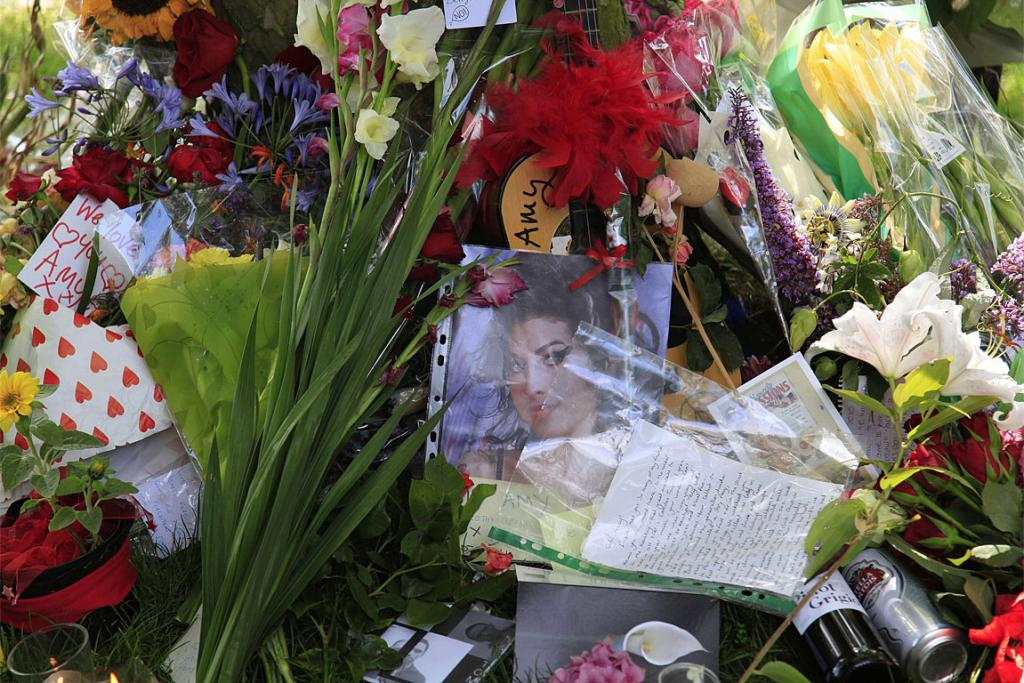 Flowers and messages are seen outside the home of Amy Winehouse.