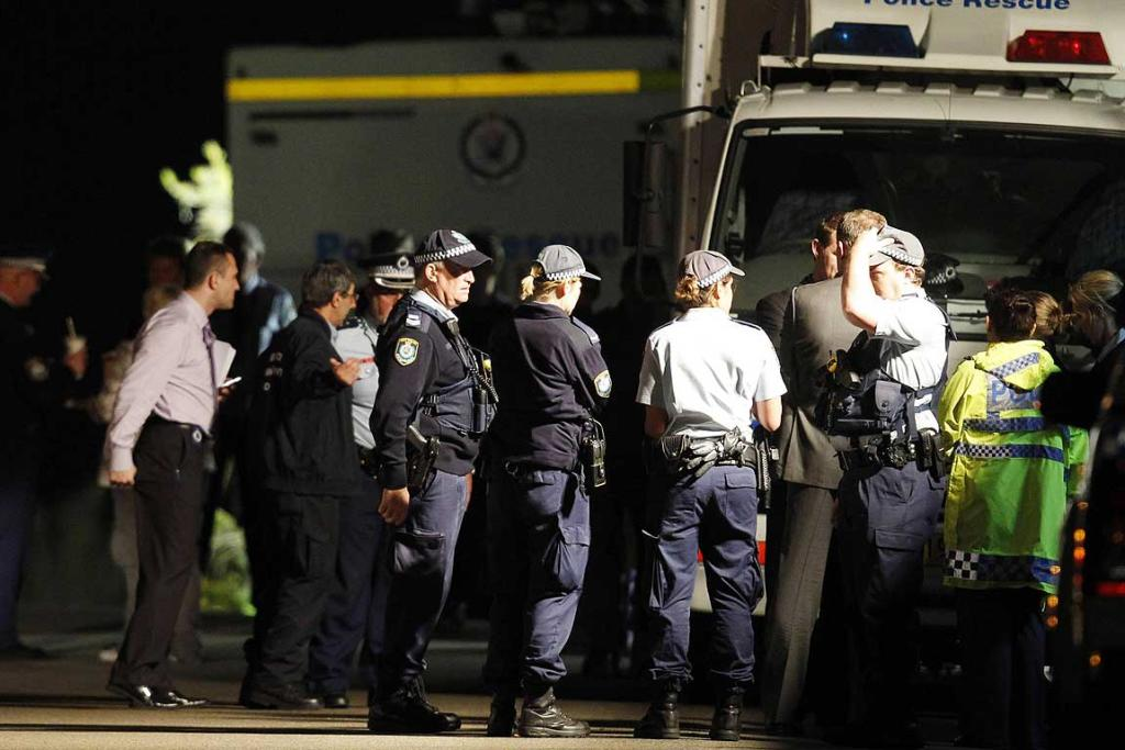 Police officers at a house where bomb squad officers were working in the exclusive Sydney suburb of Mosman.