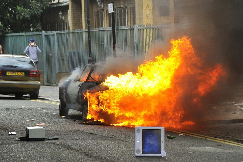 A car burns on a street in Hackney, east London.