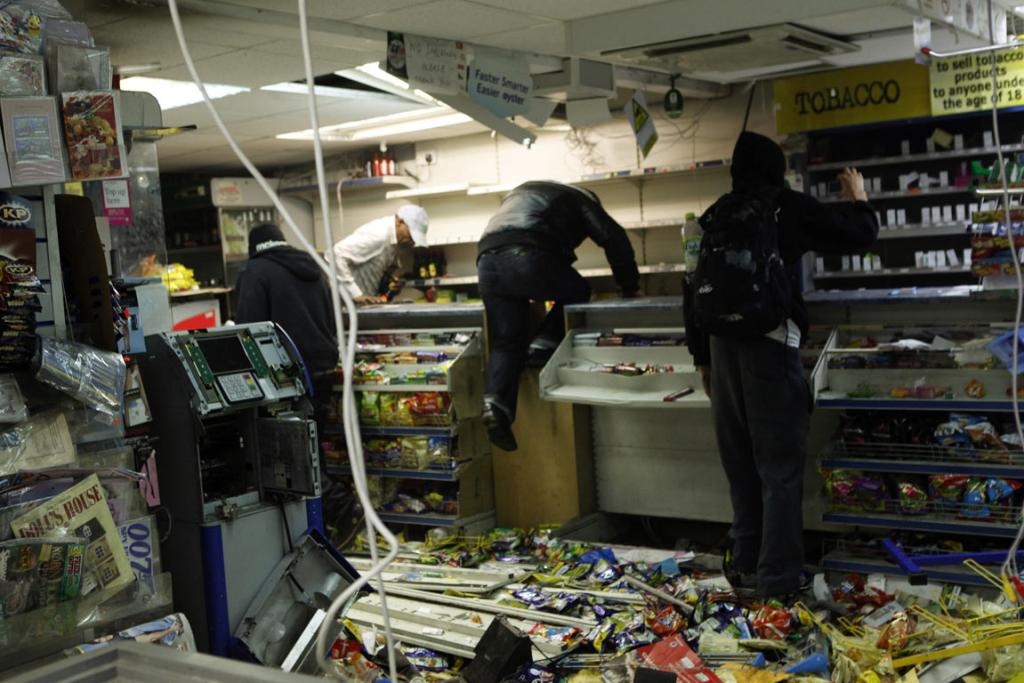 Looters rampage through a convenience store in Hackney, east London as violence broke out in the British capital for a third night.