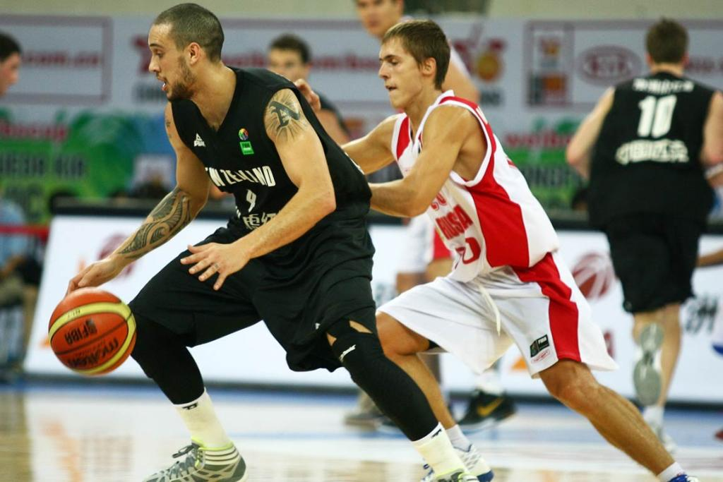 Tall Blacks guard Lindsay Tait dribbles under pressure from his Russian opposite.