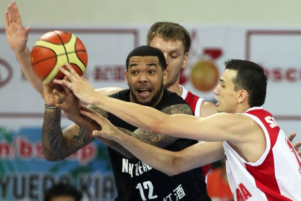 Tall Blacks forward BJ Anthony passes out of a Russian double-team.