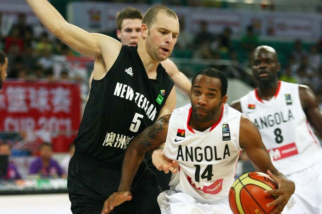 Back-up Tall Blacks point guard Michael Fitchett defends against Angola.