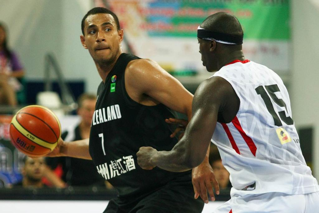 Standout New Zealand forward Mika Vukona gets ready to fire a one-handed cross-court pass.
