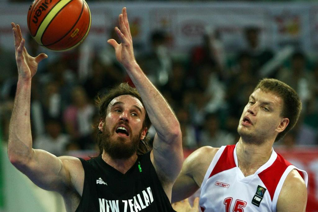 New Zealand forward Casey Frank pulls down a defensive rebound against Russia.