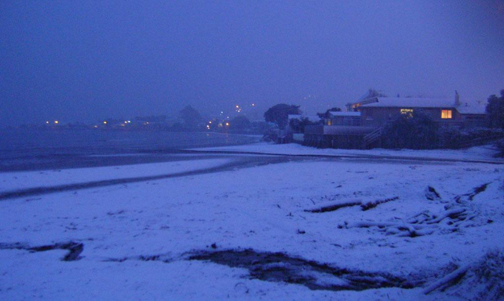 Snow on the waterfront in Plimmerton, outside of Wellington.