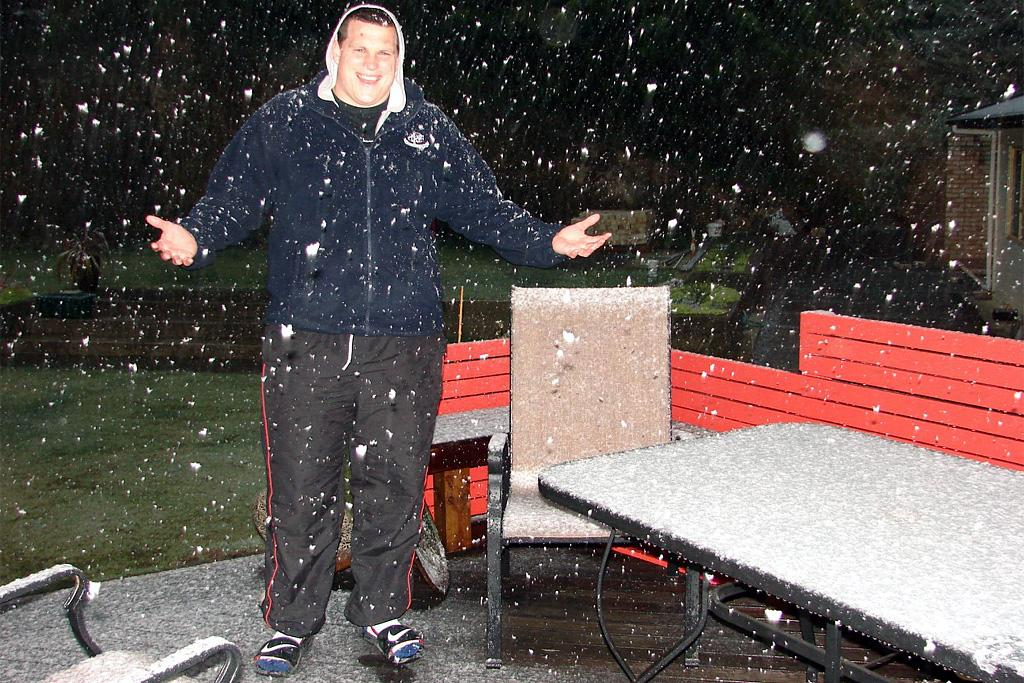 Benny Hendry poses for a photo in the snow at Glenside on Sunday night.