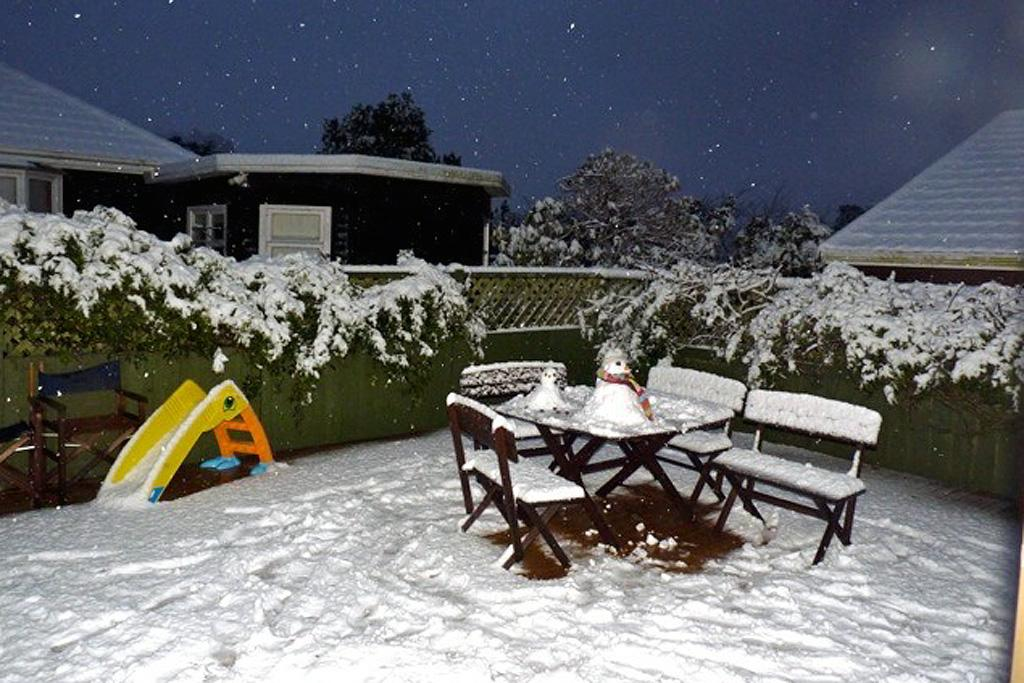 Snow fills the backyard of a Johnsonville home on Sunday.