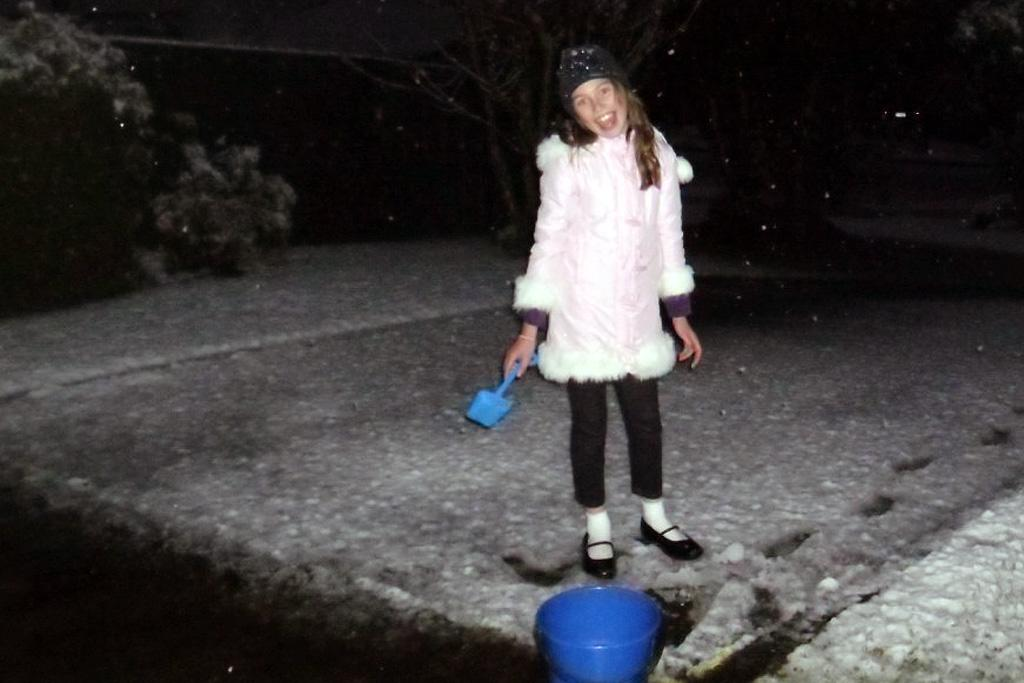 Monica Murray, 8, of Whitby, playing in the snow on Sunday night.
