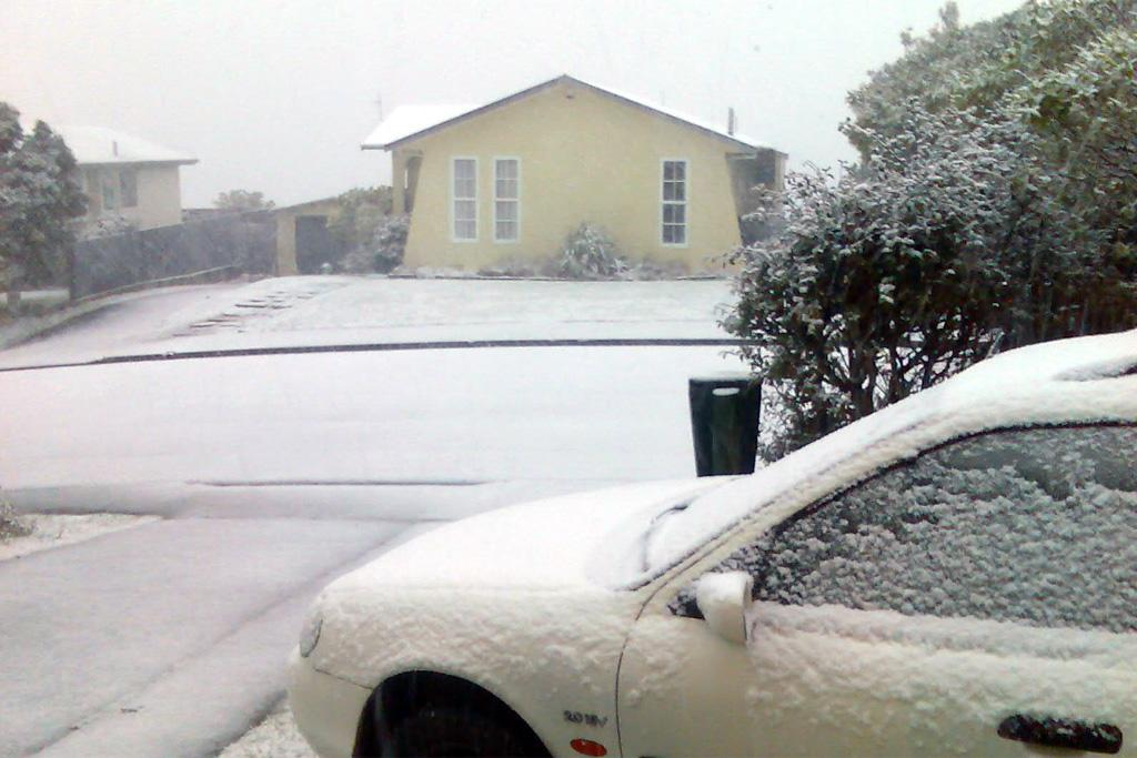 Snow covers cars and houses in Newlands on Sunday.