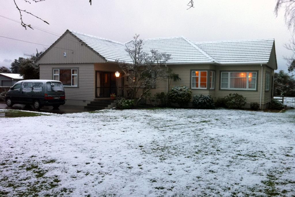 Snow covers a Marton home on Sunday.