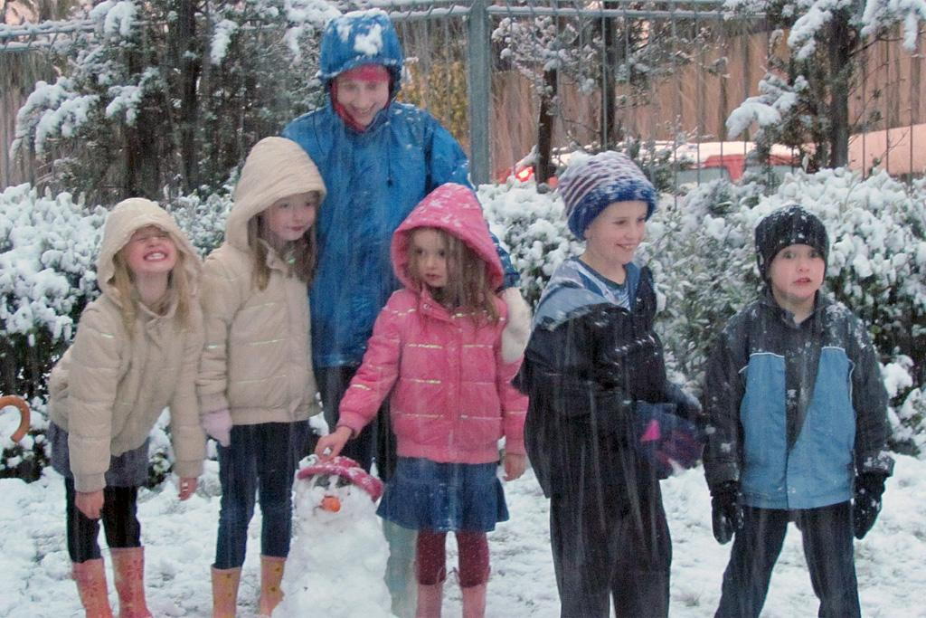 From left, Ella Clarke, Caitlin Clarke, Jessie Williams, Lucy Clarke, Ollie Williams and Timmy Williams enjoy the snow on Sunday.