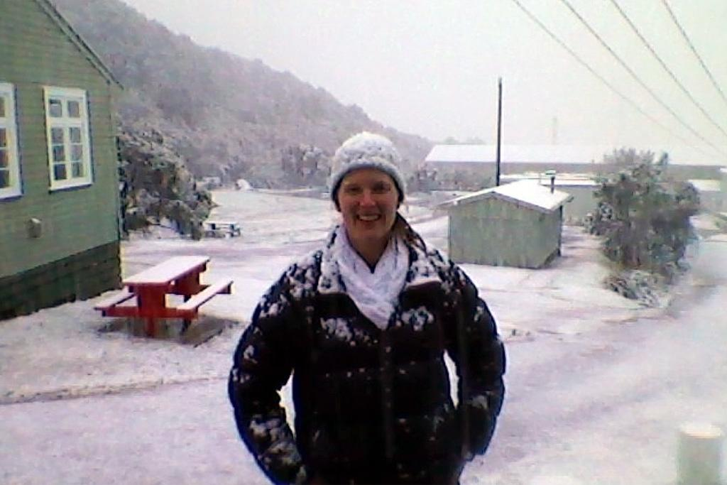 Eleanor Currier poses for a photo in the snow in Elsdon, Porirua.