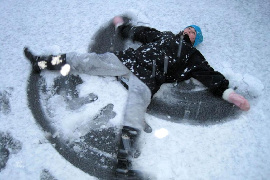 Ally Ringrose, 13, makes a snow angel in Titahi Bay.