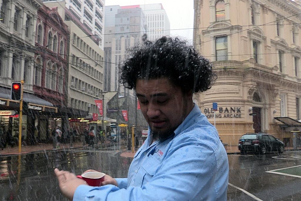 A watches as snow falls on Wellington's Lambton Quay.