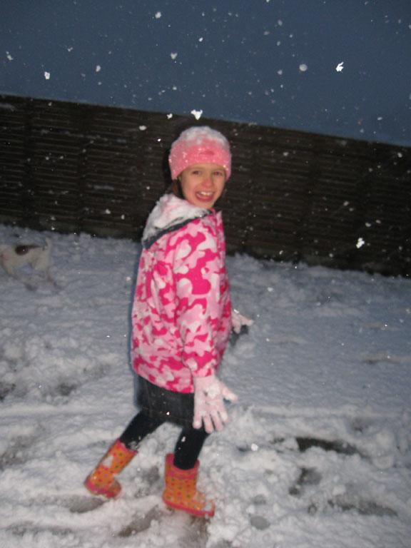 Olivia Stevens wraps up warm to brave the snow in Broadmeadows.