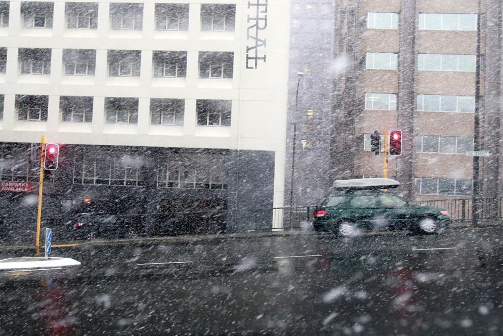 Snow buffets The Terrace in Wellington as snow falls to sea level on Monday.
