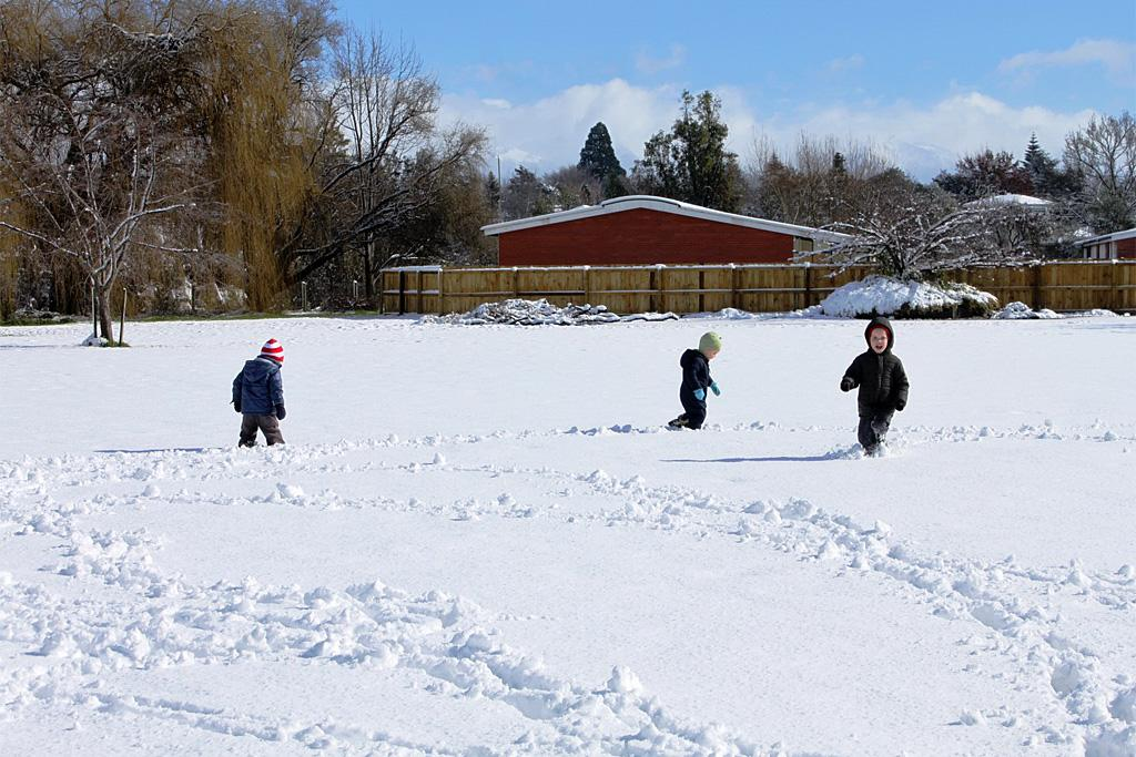 George, Hunter and Thomas Farman making first tracks in the snow in Masterton.