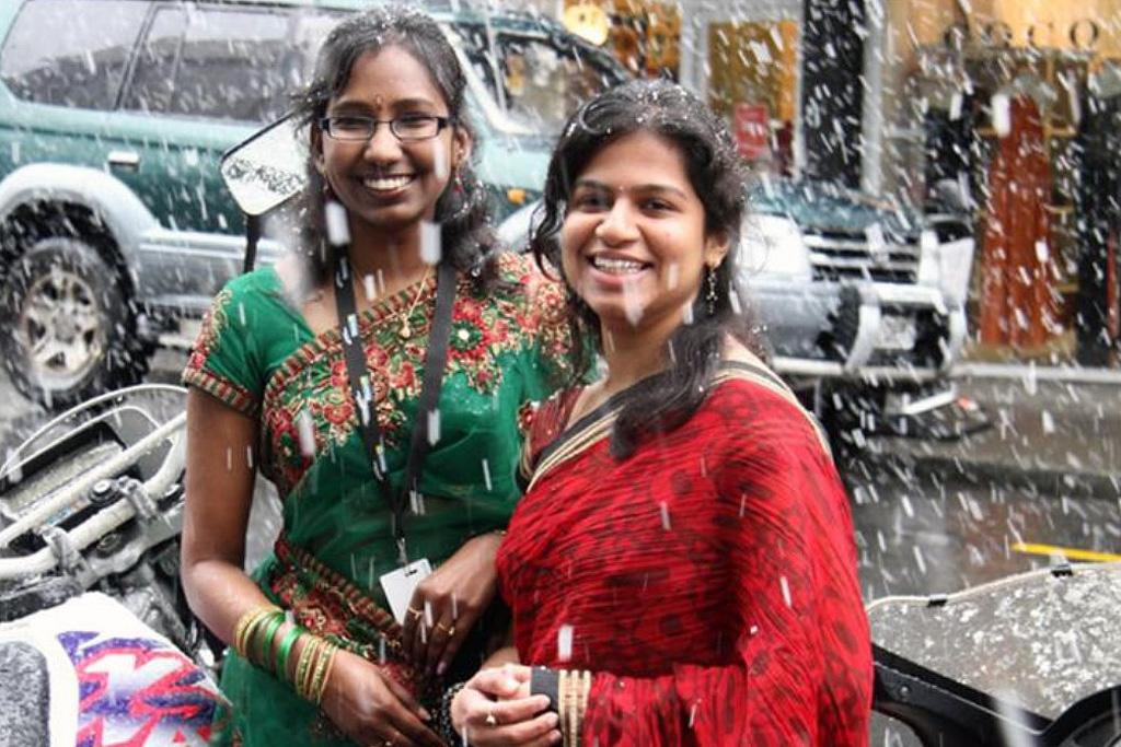 Lavanya Chevuru and Deepika Manu celebrate India Independence day on Willis St in the snow.