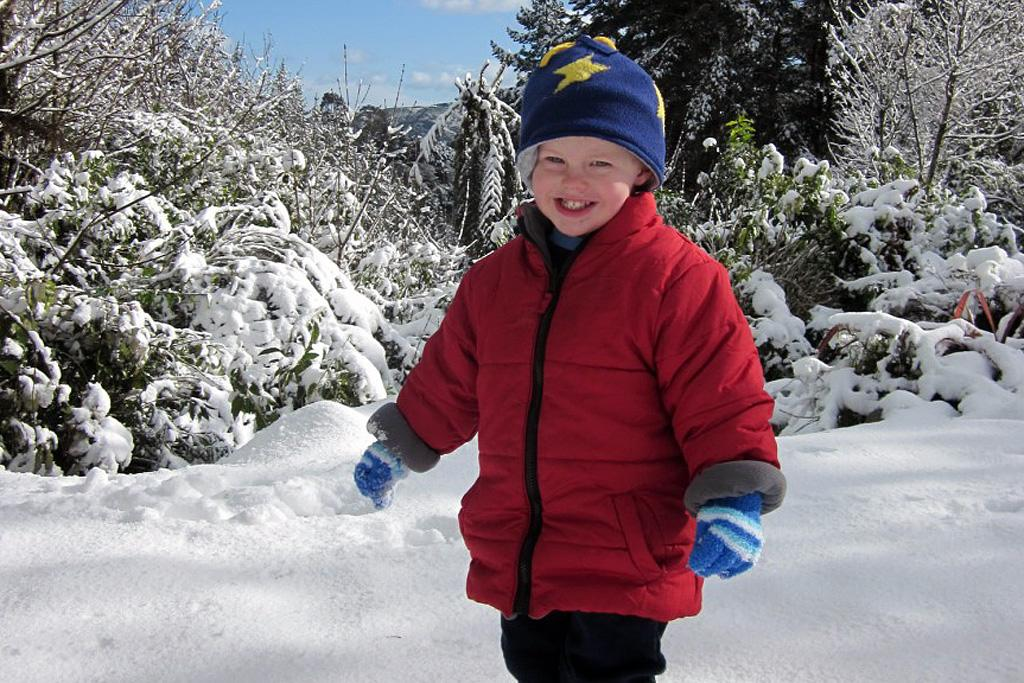 Logan Pitchford enjoys the snow in Avro Road, Whitemans Valley.
