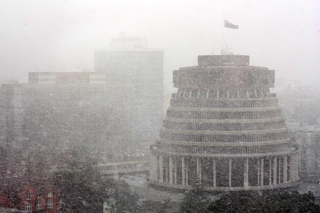 The Beehive endures a blanketing of snow in Wellington.