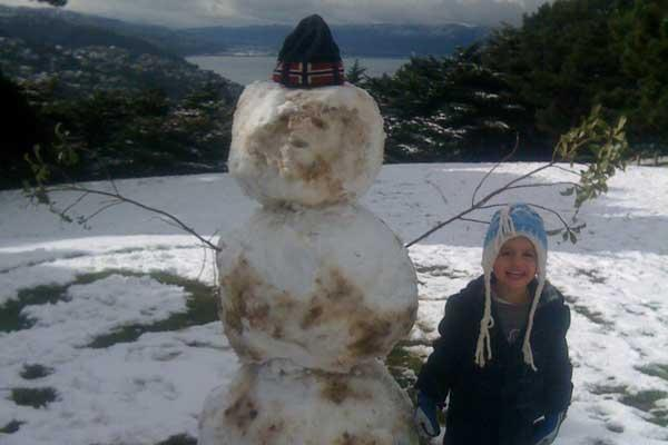 Ben Fulton chilling with with his snowman in Wellington.