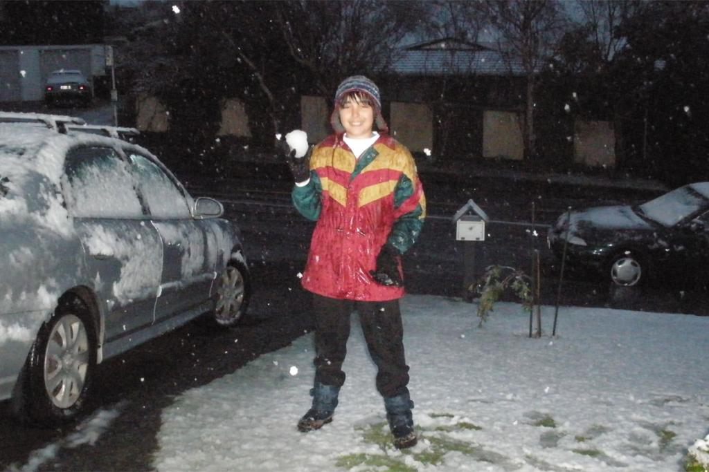 Ben Lopez, 11, playing in the snow in Whitby, outside of Wellington.
