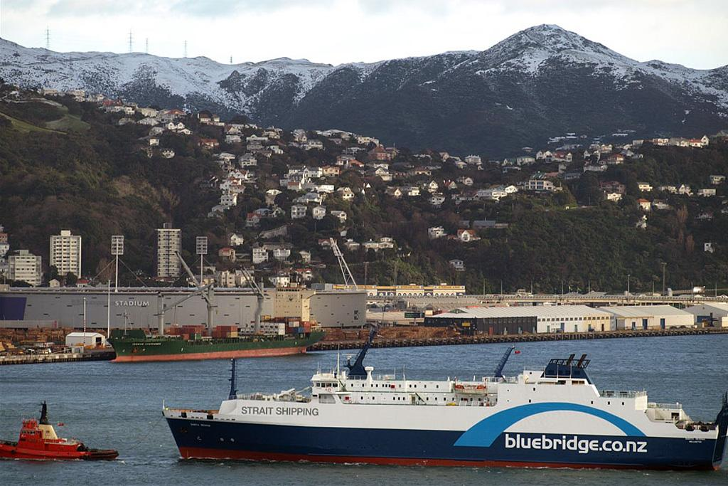 A Bluebridge ferry is turned slowly in Wellington Harbour after unsuccessfully trying to cross Cook Strait.