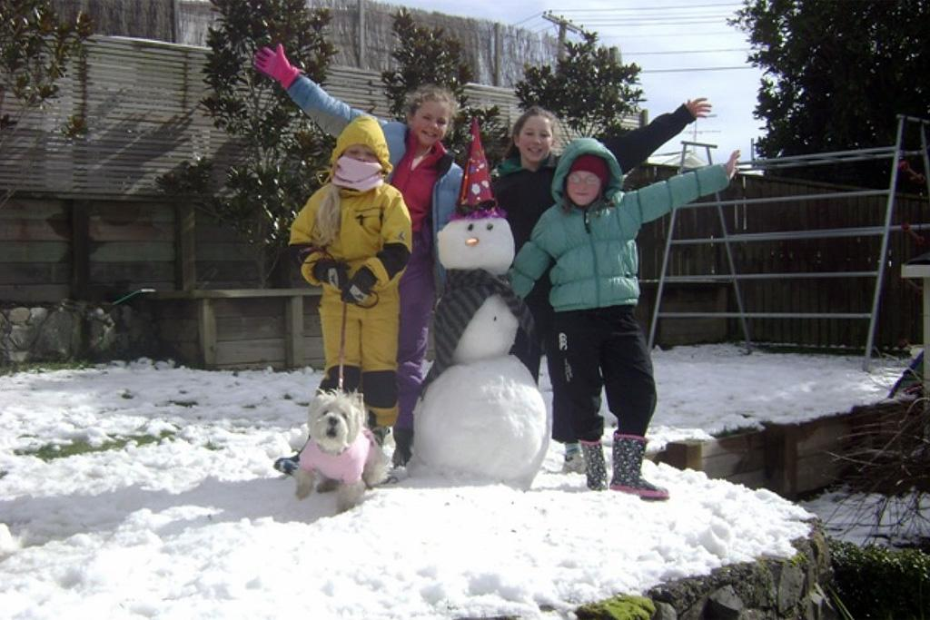 Ms Frosty in Karori with Tessa, Charlotte, Lucy and Maggie Hurley-Bruce - along with Evie the West Highland terrier.