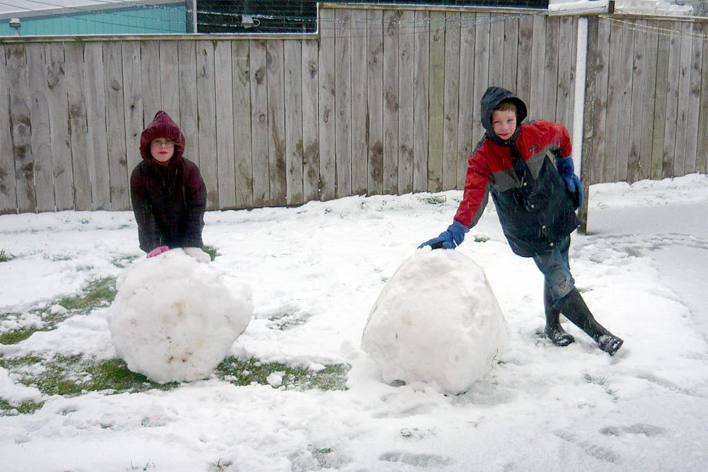 Joel and Bethany with their Giant Snowballs in Brooklyn.