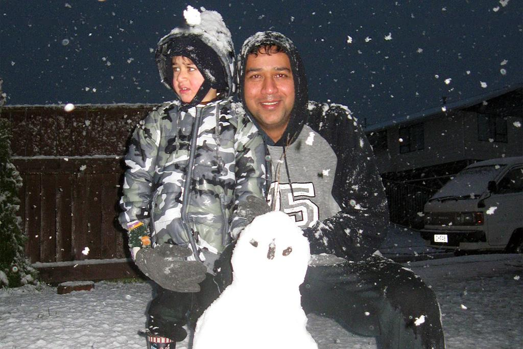 Arnav, 3, with Dad Ajay with their snowman in Kelson.