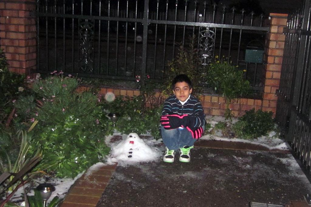 There's not too much snow to go around in Miramar - but Kishan Kumar makes do with what he can to make a snowman.