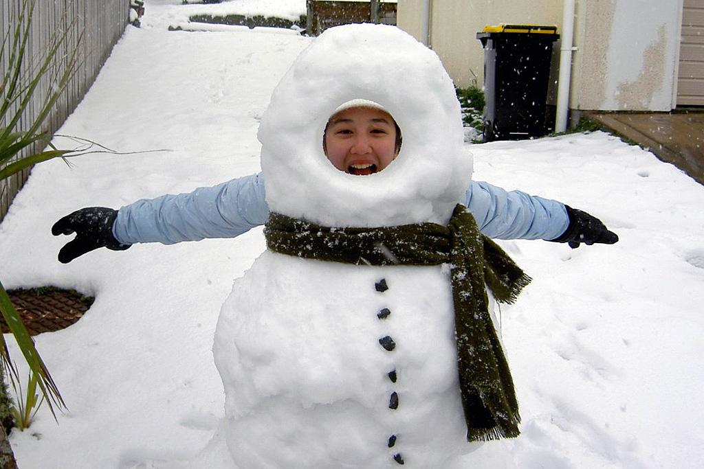 Enjoying the snow with a make-yourself-a-snowman snowman.