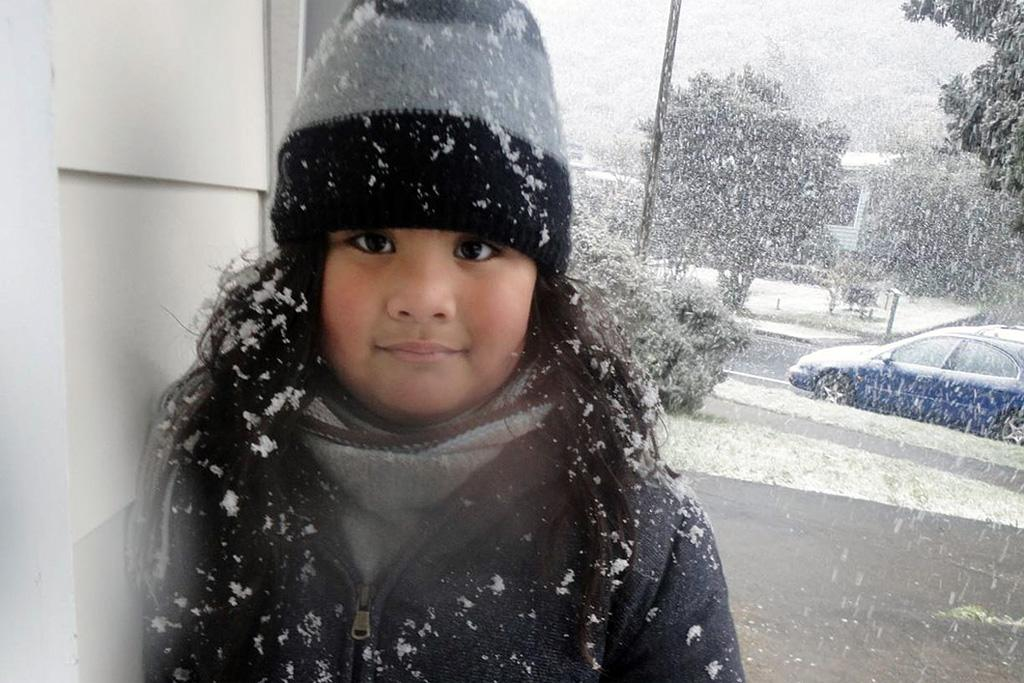 4-year-old Summer Aiono, who called her preschool herself to say she was staying home to play in the snow.