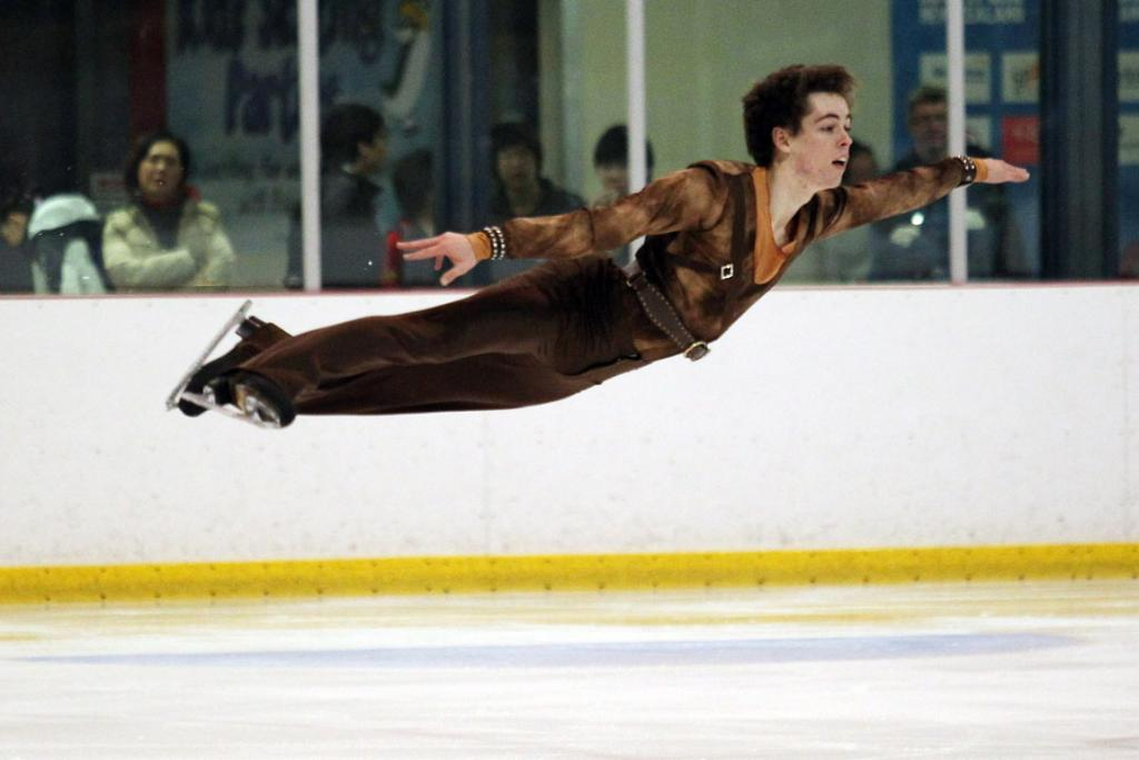Australian Andrew Dodds gets horizontal during his routine in the men's free skating competition at the Winter Games.