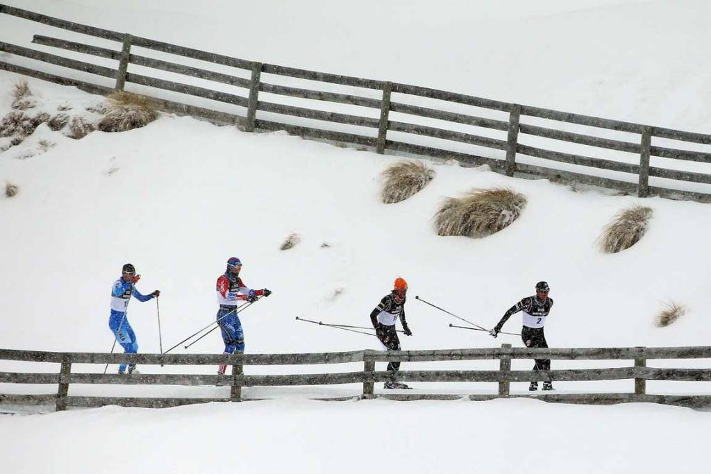 American Andrew Newell leads a group during the men's cross country sprint race.