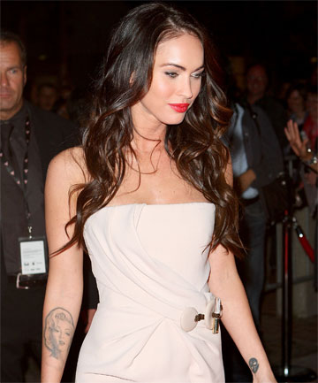 INKED: Megan Fox has been left with approximately nine tattoos after having an image of Marilyn Monroe removed from her forearm.