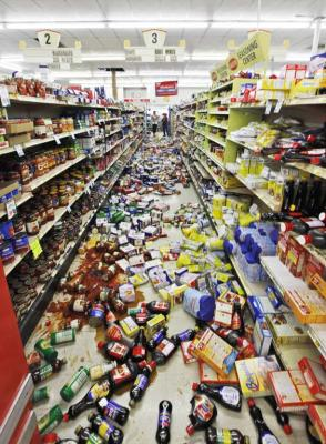 Debris covers the isle at the Miller's mart food store in Mineral, Virginia after a magnitude 5.8 earthquake hit the area.