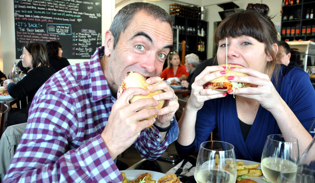 Burger Blitz: Delaney Mes chows down with British actor James Nesbitt, above. Filmmaker Morgan Spurlock, below, was the first of her 17 dates.