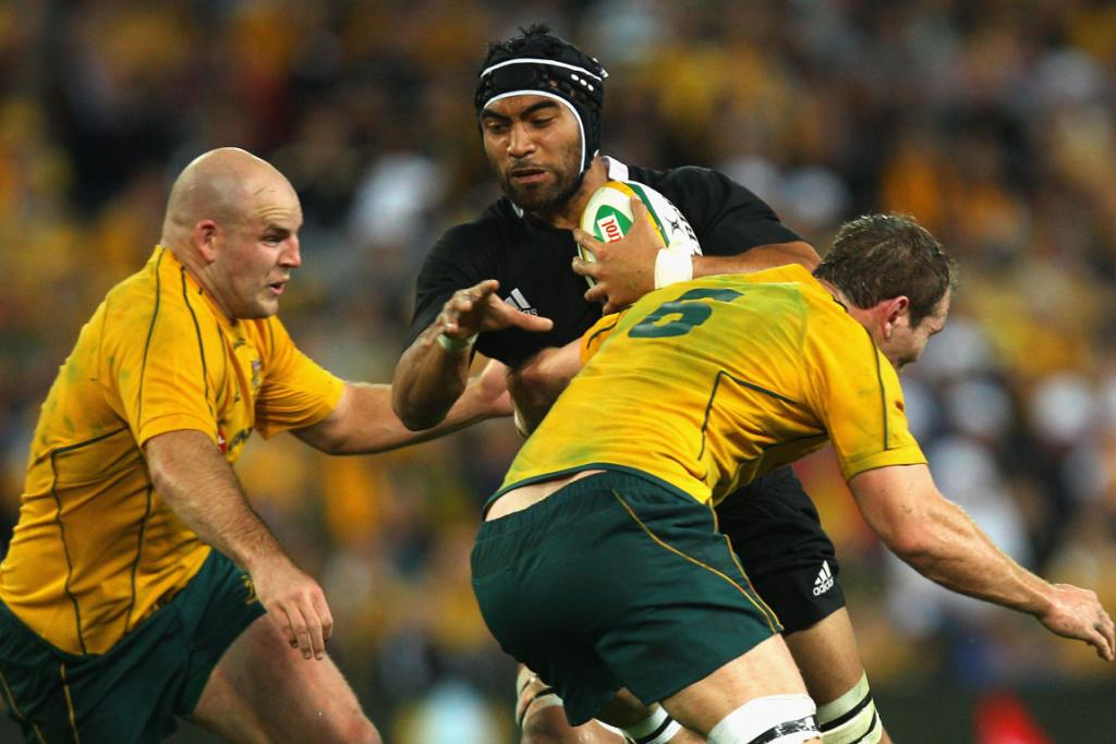 All Blacks loose forward Victor Vito takes on Wallabies defenders Stephen Moore (L) and Rocky Elsom.