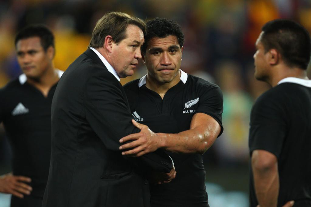 All Blacks assistant coach Steve Hansen consoles fullback Mils Muliaina after their loss to the Wallabies.