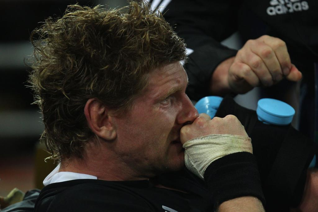 All Blacks flanker Adam Thomson nurses an arm injury after being replaced in the first half.