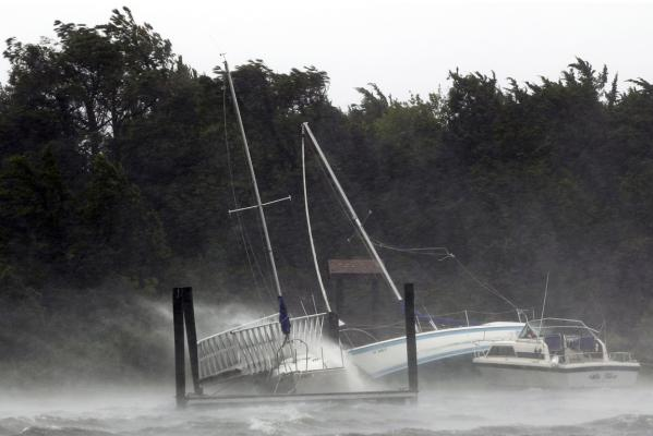 Boats are bashed against the shore and a dock in Morehead City as Hurricane Irene hits the North Carolina coast of the US.
