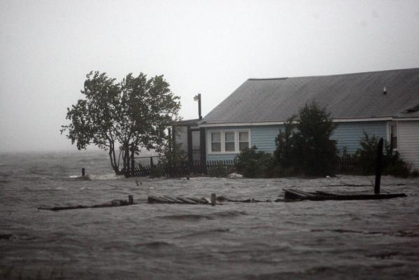 Waters lap at the foundation of a house along Calico Creek in Morehead City as Hurricane Irene bears down on the North Carolina coast of the US.